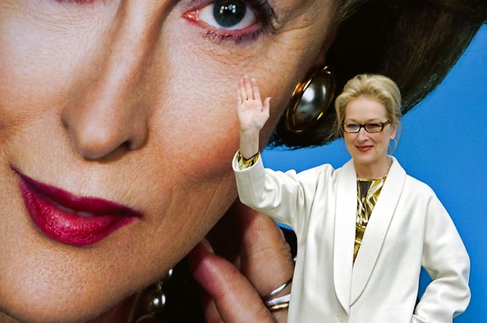 """U.S actress Meryl Streep waves as he attends a photocall for """"The Iron Lady"""" poster unveiling at a central London venue, Monday, Nov. 14, 2011. (Associated Press)"""