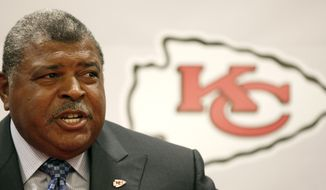 Kansas City Chiefs head coach Romeo Crennel talks to the media during a news conference announcing his promotion Monday, Jan. 9, 2012, in Kansas City, Mo. (AP Photo/Charlie Riedel)