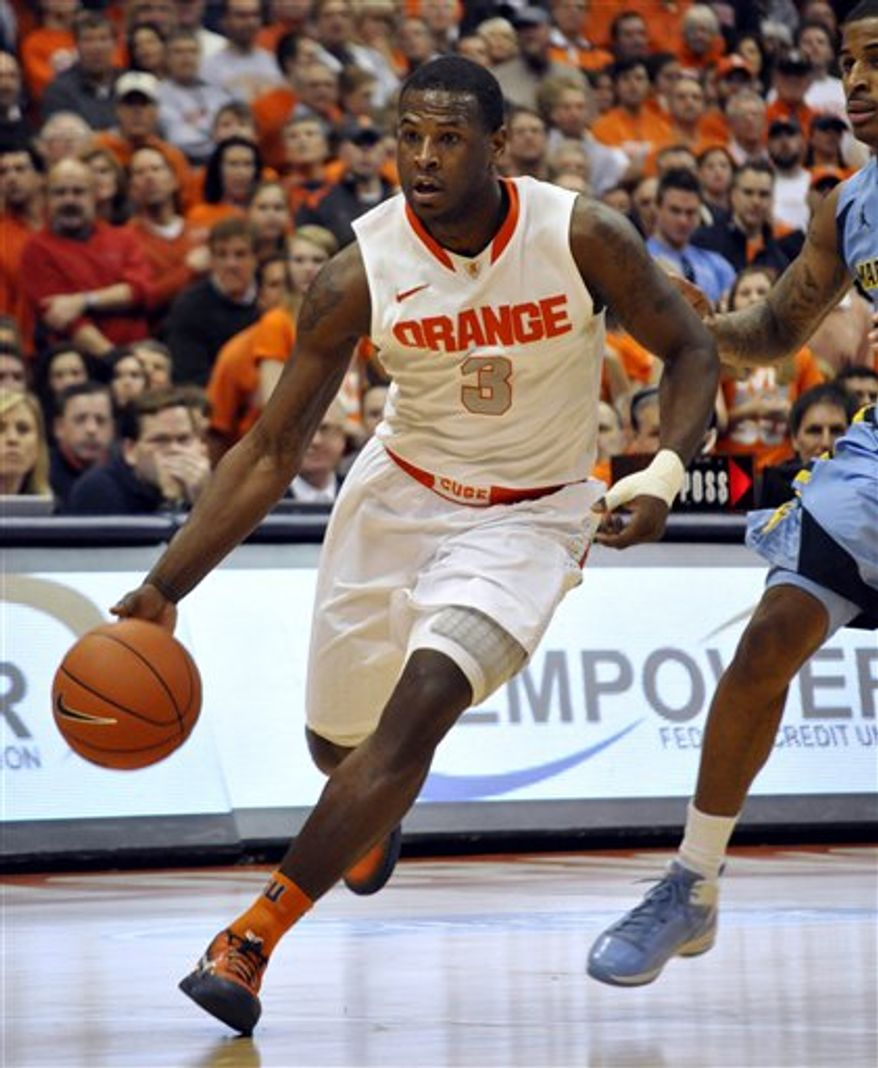 Syracuse's Dion Waiters drives against Marquette during the second half in Syracuse, N.Y., Saturday, Jan. 7, 2012. (AP Photo/Kevin Rivoli)