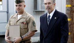 ** FILE ** Marine Staff Sgt. Frank Wuterich (left) arrives at court at Camp Pendleton, Calif., with lead defense lawyer Neal Puckett on Thursday, Jan. 5, 2012. (AP Photo/Lenny Ignelzi, File)