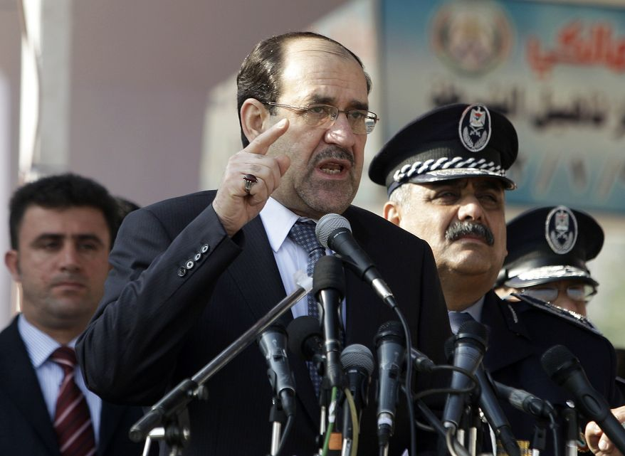**FILE** Iraq's Prime Minister Nouri al-Maliki (center) speaks at a ceremony marking Police Day at the police academy in Baghdad on Jan. 9, 2012. (Associated Press)