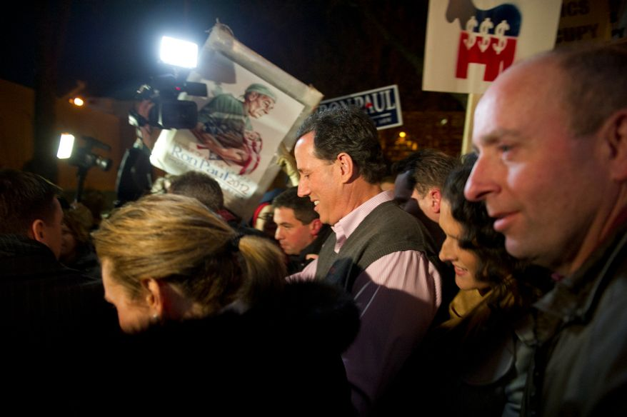One day before the nation's first presidential primary of 2012, a melee breaks out as Republican presidential candidate and former Pennsylvania Senator Rick Santorum (right), his wife Karen (left) and members of his family make their way to their car while unidentified individuals and Manchester police shove and push to open a clear way from the venue after Mr. Santorum make an appearance at a campaign rally at Jillian's Billiards Club in Manchester, N.H., Monday, January 9, 2012. (Rod Lamkey Jr/ The Washington Times)