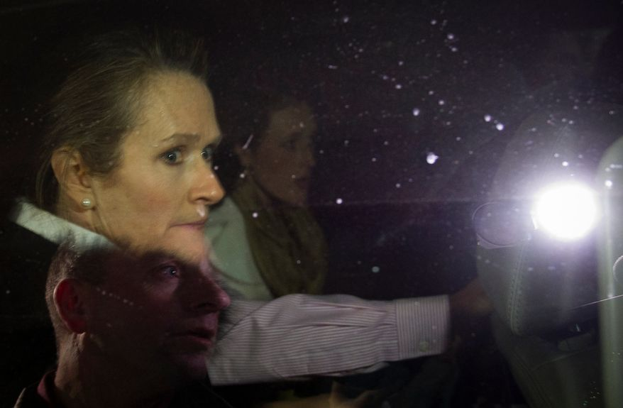 One day before the nation's first presidential primary of 2012, Karen Santorum looks from the window of an SUV as a melee breaks out as Republican presidential candidate and former Pennsylvania Senator Rick Santorum and members of his family make their way to their car while unidentified individuals and Manchester police shove and push to open a clear way from the venue after Mr. Santorum make an appearance at a campaign rally at Jillian's Billiards Club in Manchester, N.H., Monday, January 9, 2012. (Rod Lamkey Jr/ The Washington Times)