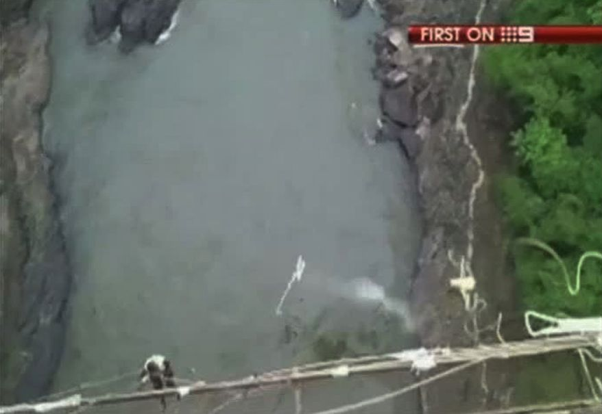 The bungee cord tied to Erin Langworthy, 22, of Perth, Australia, snaps during her jump from the Victoria Falls Bridge over the Zambezi River in Victoria Falls, Zimbabwe, on Saturday, Dec. 31, 2011. (AP Photo/Australian Channel 9 via APTN)