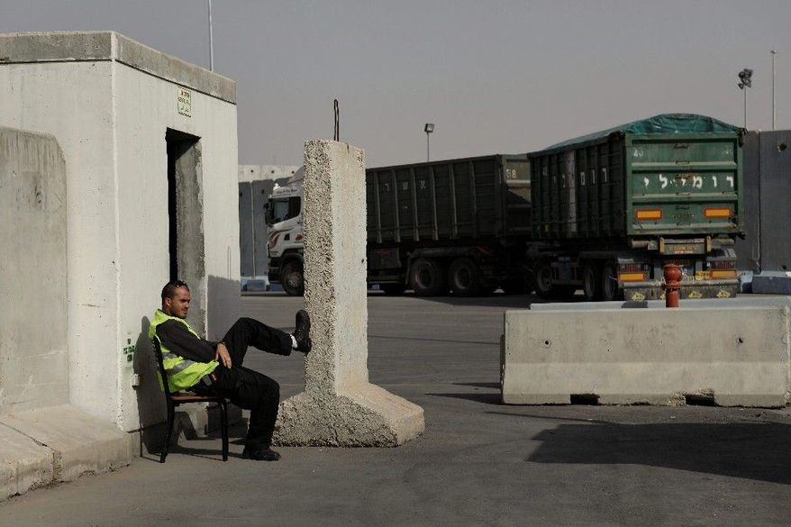 In this Monday, Dec. 19, 2011 photo, a worker rests on the Israeli side of the Kerem Shalom crossing, between Israel and the Gaza Strip. Each day, dozens of trucks move food, consumer products and industrial materials into the Gaza Strip at this heavily fortified crossing, in an odd arrangement that has turned Israel into a key supplier to a territory governed by its bitter enemy Hamas. (AP Photo/Tsafrir Abayov)