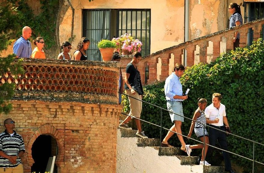 First lady Michelle Obama (center) heads down stairs at Casa del Rey Moro during a visit to Ronda in southern Spain in August 2010. Mrs. Obama went to Spain on a private trip with daughter Sasha and friends. (Associated Press)