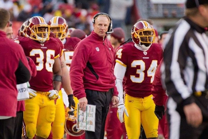 Under Jim Haslett's guidance, Washington climbed from 30th in yards allowed per play in 2010 to 17th in 2011. (Andrew Harnik/The Washington Times)