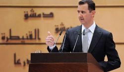 Syrian President Bashar Assad delivers a speech at Damascus University in Damascus, Syria, on Tuesday, Jan. 10, 2012. (AP File Photo/SANA)
