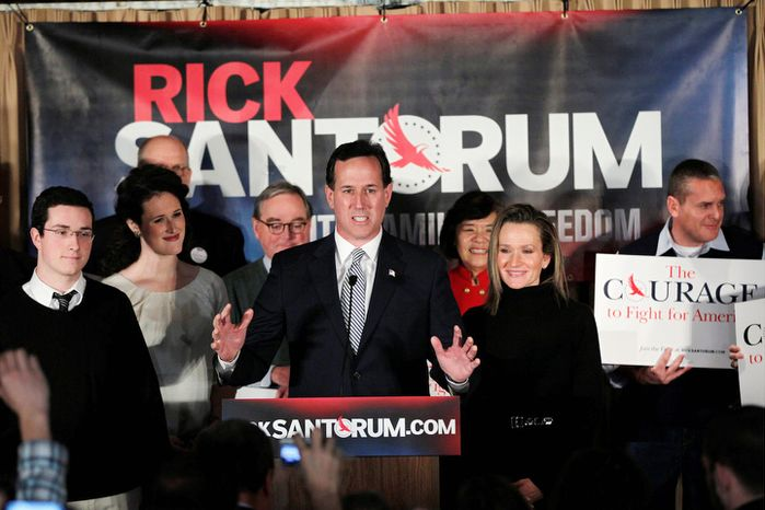 Former Pennsylvania Sen. Rick Santorum, accompanied by his wife, Karen (center right), son Daniel (left) and daughter Elizabeth (second left), speaks during a primary night rally on Tuesday, Jan. 10, 2012, in Manchester, N.H. (AP Photo/Matt Rourke)