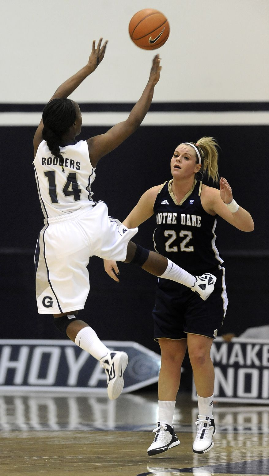 Georgetown's Sugar Rodgers goes up for a shot away from Notre Dame's Brittany Mallory (22) during second half of an NCAA basketball game, Tuesday, Jan. 10, 2012, in Washington. Notre Dame defeated Georgetown 80-60. (AP Photo/Richard Lipski)