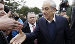 Rep. Ron Paul campaigns outside a polling station at Webster School in Manchester, N.H., on Tuesday, Jan. 10, 2012. (AP Photo/Charles Dharapak)