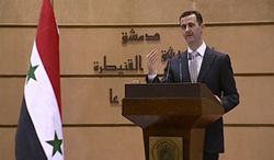 Syrian President Bashar Assad delivers a two-hour speech at Damascus University in Damascus, Syria, on Tuesday, Jan. 10, 2012. (AP Photo/Syrian State Television via APTN)