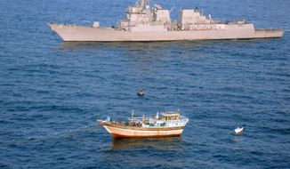 ** FILE ** The guided-missile destroyer USS Kidd responds to a distress call from the master of the Iranian-flagged fishing dhow Al Molai, who claimed he was being held captive by pirates in the Arabian Sea on Thursday, Jan. 5, 2012. (AP Photo/U.S. Navy)