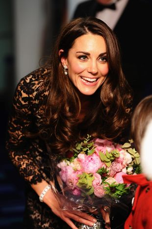 """The Duchess of Cambridge arrives for the U.K. premiere of """"War Horse"""" Sunday in London. Summer visits to Canada and the United States with Prince William after their April wedding brought her gifts ranging from mosquito traps to an iPad. (Associated Press)"""