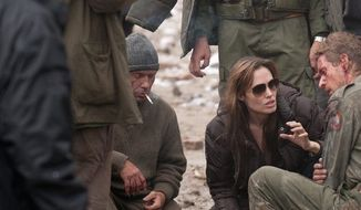 "Director Angelina Jolie, talking with actors in ""In the Land of Blood and Honey,"" says she doesn't think of the film, which she also wrote, as having a partisan tilt in the ethnic strife endemic to Bosnia. (Film District via Associated Press)"