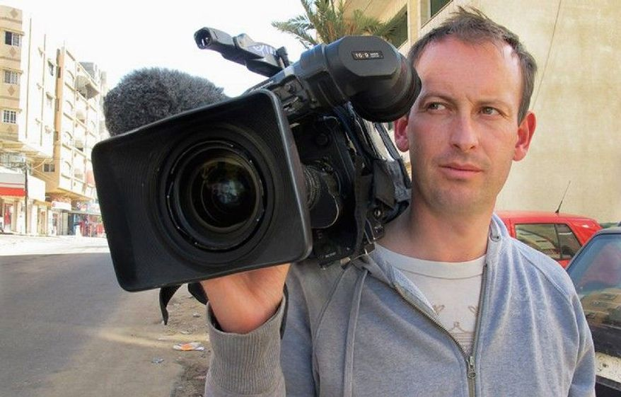 French television cameraman Gilles Jacquier, seen at an unknown location in an undated photo, was killed Wednesday in Homs, Syria, when a group on an official media trip was hit by grenades that also killed several Syrian civilians. (Associated Press)