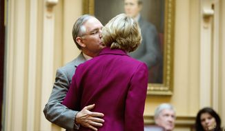 In a gesture of interparty collegiality, Sen. Thomas K. Norment Jr., James City Republican, kisses Sen. Janet Howell, Fairfax Democrat, before the interparty disagreements began on opening day.