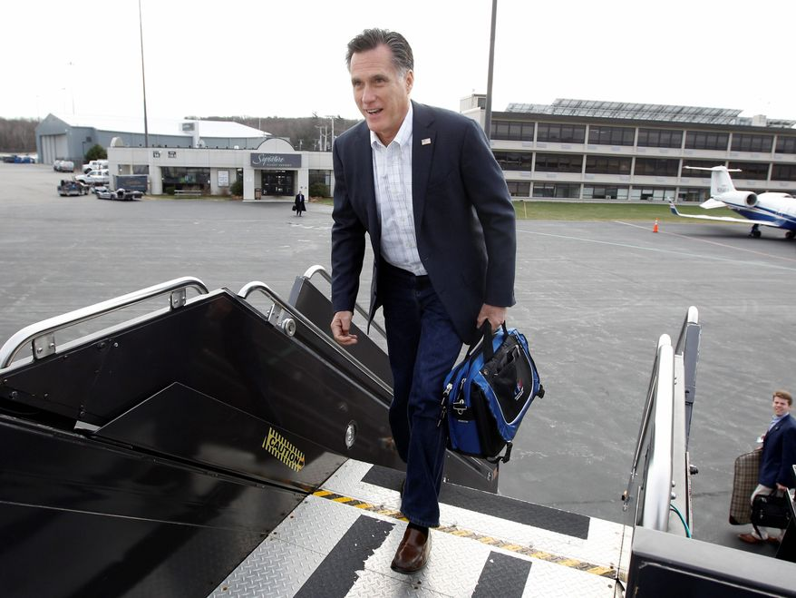 Republican presidential hopeful Mitt Romney boards his campaign plane Wednesday in Bedford, Mass., heading for South Carolina, site of the next primary contest on Jan. 21. His strong stance against illegal immigration dovetails with South Carolina's tough new law. (Associated Press)