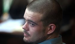 Joran van der Sloot looks back from his seat after entering the courtroom for the continuation of his murder trial at San Pedro Prison in Lima, Peru, on Wednesday, Jan. 11, 2012. Van der Sloot pleaded guilty to the 2010 murder of a 21-year-old Peruvian woman he met at a Lima casino who was killed five years to the day after the unsolved disappearance in Aruba of an American teen, in which he remains the main suspect. (Associated Press)