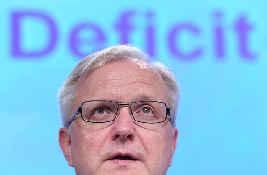 Olli Rehn, European commissioner for economic and monetary affairs, addresses Hungary's fiscal situation at the European Commission headquarters in Brussels on Wednesday, Jan. 11, 2012. (AP Photo/Yves Logghe)