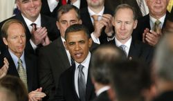 President Obama, accompanied by leaders from the private sector and the government, speaks in the East Room of the White House in Washington on Wednesday, Jan. 11, 2012, to encourage companies to insource and invest in America. (AP Photo/Manuel Balce Ceneta)