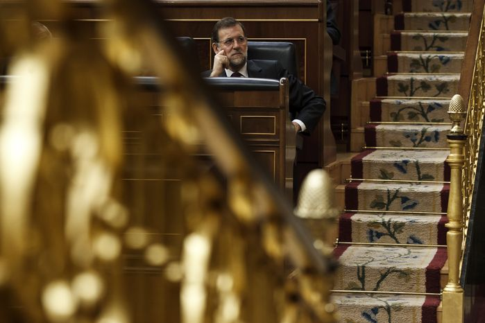 Spain's Prime Minister Mariano Rajoy attends Jan. 11, 2012, a plenary session at the Spanish Parliament in Madrid to approve the new conservative government's first batch of austerity measures. (Associated Press)