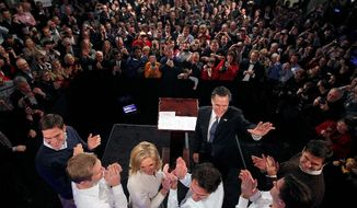 "Mitt Romney celebrates with supporters, his wife, Ann, and five sons at Tuesday's victory party in New Hampshire. A survey with no church ties found that 56 percent of Mormons think the country is ""ready"" to consider a member of their faith as president. (Associated Press)"