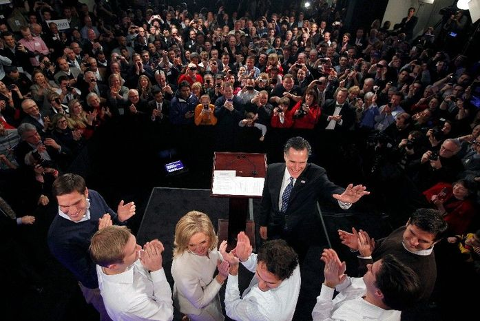 """Mitt Romney celebrates with supporters, his wife, Ann, and five sons at Tuesday's victory party in New Hampshire. A survey with no church ties found that 56 percent of Mormons think the country is """"ready"""" to consider a member of their faith as president. (Associated Press)"""