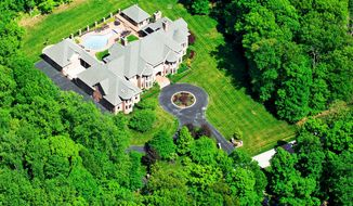 The estate's 3 acres of landscaped grounds include a circular driveway.