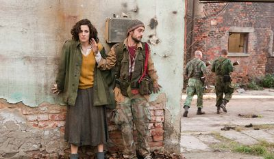 "Zana Marjanovic (left) and Boris Ler play characters caught up in the war in Bosnia in the film directed and co-written by Angelina Jolie, ""In the Land of Blood and Honey."" (Film District via Associated Press)"