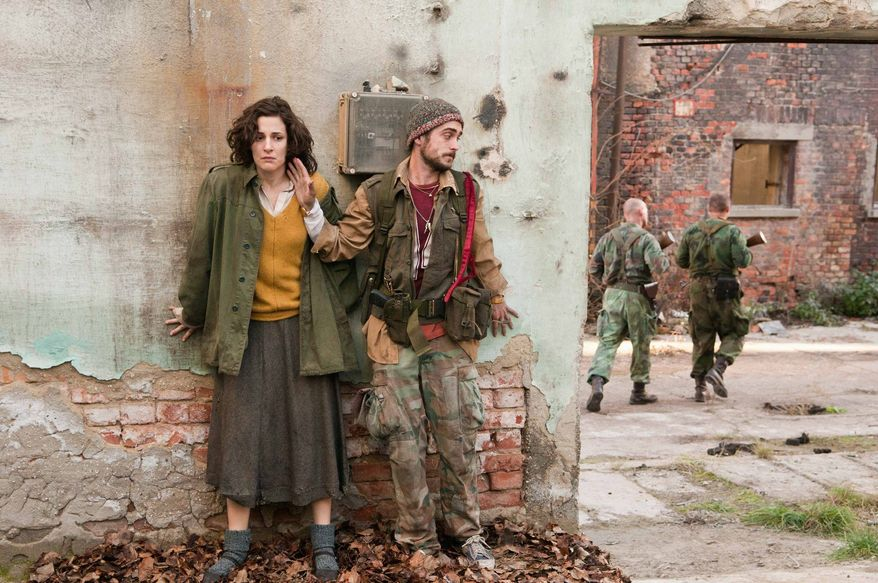 """Zana Marjanovic (left) and Boris Ler play characters caught up in the war in Bosnia in the film directed and co-written by Angelina Jolie, """"In the Land of Blood and Honey."""" (Film District via Associated Press)"""
