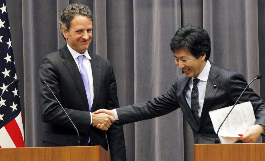 U.S. Treasury Secretary Timothy Geithner (left) shakes hands Jan. 12, 2012, with his Japanese counterpart Jun Azumi after their joint press conference in Tokyo. (Associated Press)