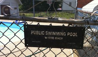 "This June 9, 2011, photo provided by Michael Gunn shows a ""white only"" sign posted on the gate to a swimming pool at a duplex in Cincinnati where Mr. Gunn lived. (AP Photo/Michael Gunn)"