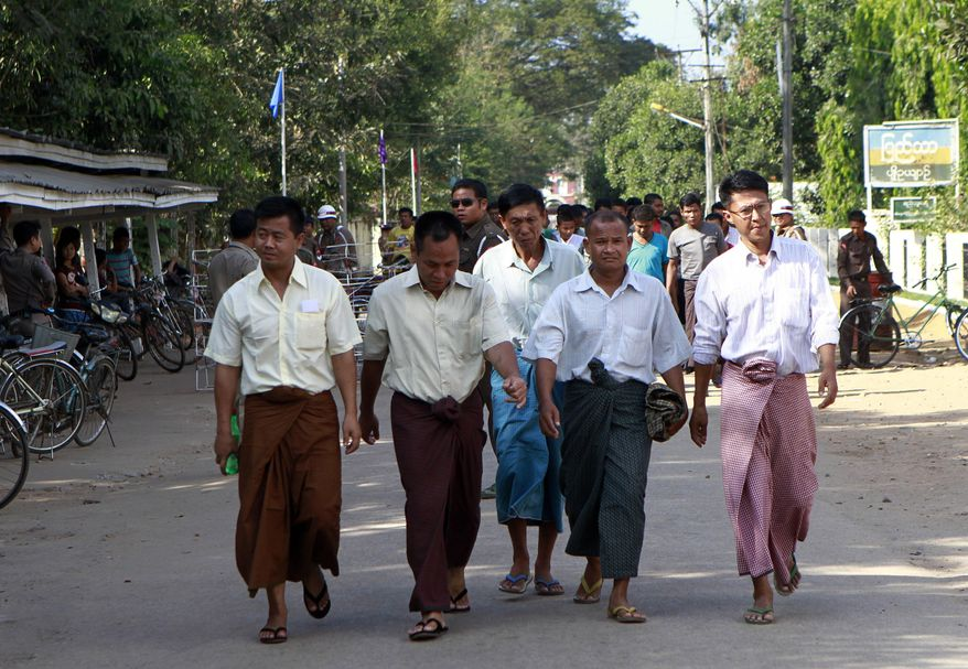 Freed inmates leave the Insein prison in Yangon, Myanmar, on Jan. 3, 2012. Families of political prisoners in Myanmar say a government clemency offer falls short of national reconciliation promises and shows that prisoners of conscience may remain incarcerated for a long time. (Associated Press)