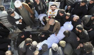 The shrouded body of Mostafa Ahmadi Roshan, a chemistry expert and a director of the Natanz uranium enrichment facility in central Iran, is seen prior to be buried in Tehran on Jan. 13, 2012. Roshan was killed two days earlier when two assailants on a motorcycle attached a magnetic bomb to his car. (Associated Press/Iranian Students News Agency)