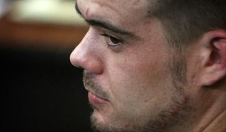 Joran van der Sloot, 24, sits Jan. 13, 2012, in the courtroom at San Pedro prison in Lima, Peru, before he received a 28-year sentence for the 2010 murder of Stephany Flores, a young woman he met at a Lima casino. (Associated Press)