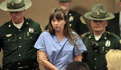 **FILE** Julianne McCrery, 42, of Irving, Texas, arrives May 19, 2011, at District Court in Portsmouth, N.H. McCrery was charged with suffocating her 6-year-old son in a New Hampshire motel room and leaving his body by a road in Maine. (Associated Press)