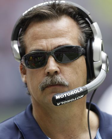 FILE - In this Nov. 28, 2010, file photo, Tennessee Titans' Jeff Fisher looks on during the first quarter of the Houston Texans in Houston. A person familiar with the decision says Jeff Fisher has accepted an offer to coach the St. Louis Rams. The person confirmed the agreement to The Associated Press on Friday