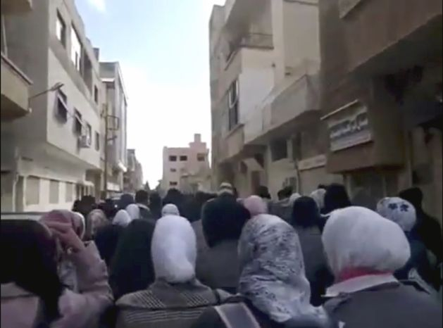 This image from amateur video made available by the Ugarit News group and shot Jan. 12, 2012, purports to show protesters demonstrating against the killing of a French journalist in Daraa, Syria. (Associated Pres