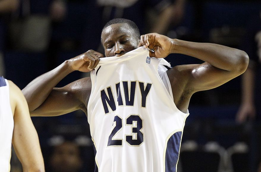Navy guard Donya Jackson reacts after receiving an offensive foul call in the second half against Army in Annapolis, Md., Saturday, Jan. 14, 2012. Army won 75-62. (AP Photo/Patrick Semansky)
