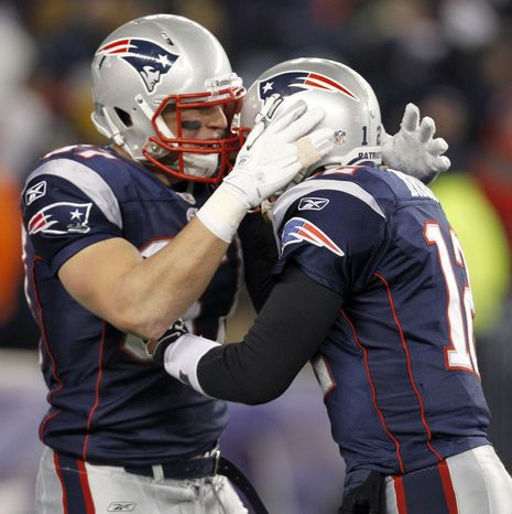 New England Patriots tight end Rob Gronkowski celebrates one of his three touchdown receptions against the Denver Broncos on Saturday, Jan. 14, 2012, in Foxborough, Mass. Quarterback Tom Brady threw for six touchdowns and 363 yards in the 45-10 win.(AP Photo/Elise Amendola)
