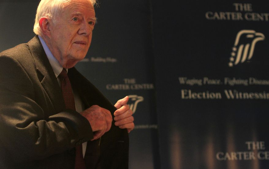 Former U.S. President Jimmy Carter leaves a press conference in Cairo, Egypt, Friday, Jan. 13, 2012. He says Egypt's political groups, including the powerful Muslim Brotherhood, told him they want to assume full authority over state affairs, including the military budget, despite attempts by ruling generals to retain some power. (AP Photo/Khalil Hamra)