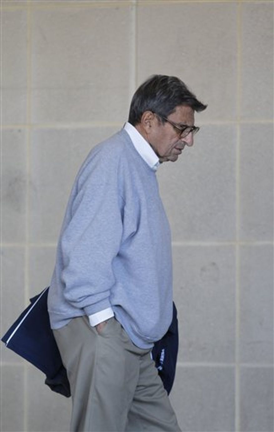 Penn State coach Joe Paterno leaves the Louis and Mildred Lasch Football Building on campus Tuesday, Nov. 8, 2011, in State College, Pa. Paterno made his first public comments since being fired two months ago to The Washington Post. (AP Photo/Matt Rourke)
