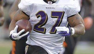 Baltimore Ravens running back Ray Rice had 1,364 yards and 12 touchdowns on the ground this season. (AP Photo/Darron Cummings)