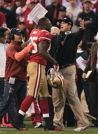 San Francisco 49ers tight end Vernon Davis is greeted by head coach Jim Harbaugh after scoring on a 14-yard touchdown reception against the New Orleans Saints during the fourth quarter Saturday, Jan. 14, 2012, in San Francisco. The 49ers won 36-32. (AP Photo/Jeff Chiu)