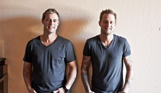 "Bryan (left) and chef Michael Voltaggio have a shared passion - cooking - that has transformed decades of sibling rivalry into a fruitful cooperation. They were featured on Season 6 of Bravo's ""Top Chef"" program. (Associated Press)"
