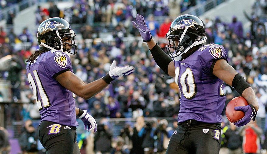 Ravens safety Ed Reed (right) celebrates his interception with cornerback Lardarius Webb during Baltimore's 20-13 victory over Houston in the AFC playoffs. Reed also made six tackles. (Associated Press)