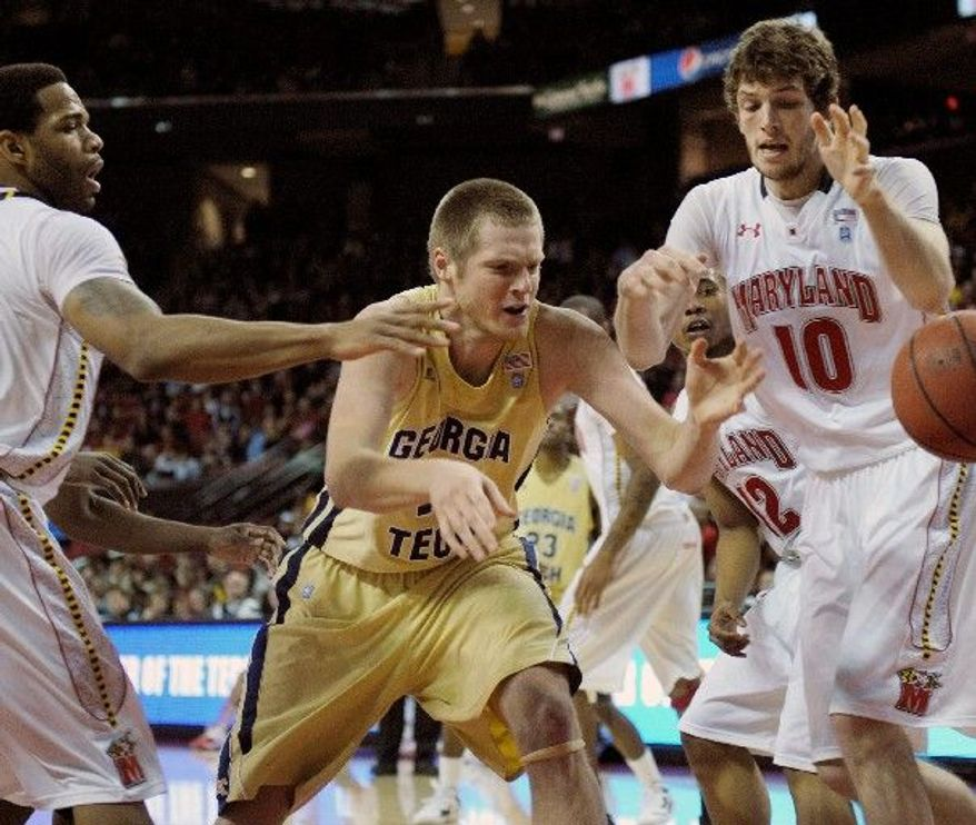 Defended by Maryland center Berend Weijs, Georgia Tech's Nate Hicks loses the ball during the Terps' 61-50 win Sunday. (Associated Press)