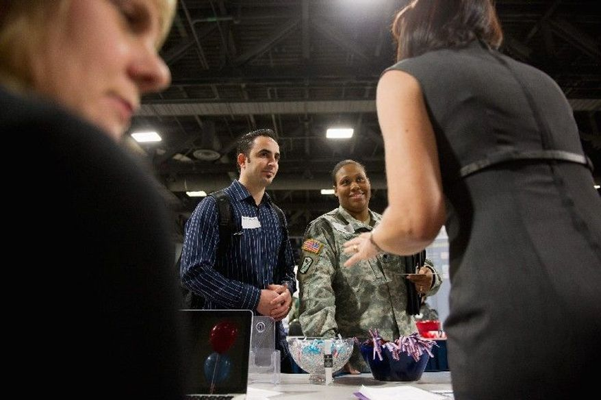 Mercedes Bagceci, an Army specialist, and her husband, Ismail, who met in Iraq, attended a job fair in the District dedicated to helping military spouses. (Andrew Harnik/The Washington Times)