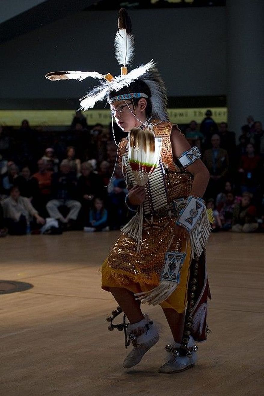 Zephaniah, 10, a member of the St. Labre Indian School Dance Troupe from Ashland, Mont., performs a Crow tribal dance at the storytelling festival. (Barbara L. Salisbury/The Washington Times)